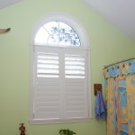 3.5 inch Rear Tilt white Plantation custom interior shutters with an arch Millville DE