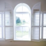 Open white arched plantation custom interior shutters Millville DE