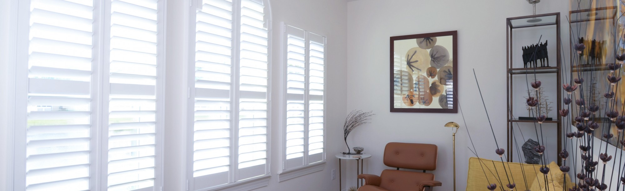 White interior shutters in front of a living space Millville DE