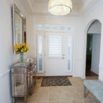 Entry way view of front door with custom shutters and custom side window shutters