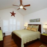 A bedroom with interior blinds from A Shade Above Millville DE