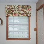 Flower patterned custom draperies with white blinds in a white room Millville DE
