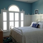 Blue beachy bedroom with custom shutters