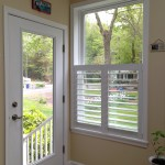 A door and a window with custom shutters