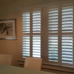 Interior view of custom shutters and wall picture